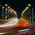 Speed traffic light trails on city road at night long exposure abstract urban background Stock Image