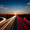 Speed Traffic  long exposure on motorway highway at sundown Royalty Free Stock Photo