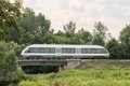 Speed train on railway at the country landscape Royalty Free Stock Photo