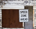 Speed zone sign ahead against geometric building facade Stock Photos