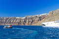Speedboat high volcanic cliff santorini island greece Royalty Free Stock Photo