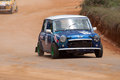 Speeding mini coopers racing car in diyathalawa fox hill super cross event in srilanka april Royalty Free Stock Image