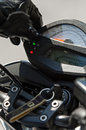 Speedometer on motorbike with hand of driver in black leather glove Royalty Free Stock Photos