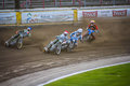 Speedway race four riders on motorbikes during in rybnik poland Royalty Free Stock Images
