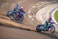Speedway race riders during dangerous on round track local championship in poland Stock Photos