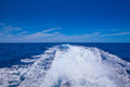 Speedy boat prop wash white wake on the blue ocean sea Stock Photo
