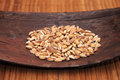 Spelt grains or farro over wooden holder Stock Image