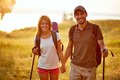 Spending leisure together portrait of couple of happy hikers in the countryside looking at camera Royalty Free Stock Photos
