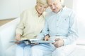 Spending time together portrait of a candid senior couple reading book at leisure Royalty Free Stock Photo