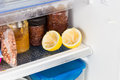 Spent lemons recycled in refrigerator to deodorize bad smell Royalty Free Stock Image