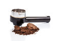 Spent or used coffee grounds with portafilter at the background Stock Photography