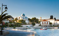 Spetses promenade and cathedral complex town on the aegean island of greece showing the old monastery of agios nikolaos which is Stock Image