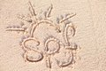 Spf handwritten on sand on a barbados beach remote tropical beaches and countries travel concept Royalty Free Stock Photos