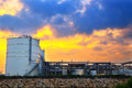 Sphere tank of storage gas and liquid chamical at sunset Royalty Free Stock Photos