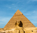 Sphinx face pyramid khafre centered blue sky the great forward in front of the largest egyptian of in giza cairo egypt on a day Royalty Free Stock Photography