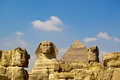 The sphinx and giza great pyramid under blue skies Stock Photo