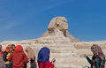 Sphinx at giza young women on cell phones in front of it Stock Photo