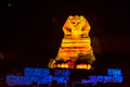 Sphinx at night of giza in egypt lit by spot lights in the evening during the light and sound show Royalty Free Stock Images