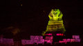 Sphinx at night of giza in egypt lit by spot lights in the evening during the light and sound show Stock Photo
