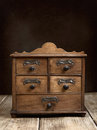 Spice cabinet vintage on rustic wooden table Stock Images