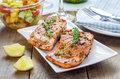 Spice grilled salmon with mango avocado salsa on a white plate Stock Image