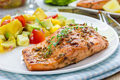 Spice grilled salmon with mango avocado salsa on a white plate Stock Photo