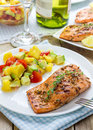 Spice grilled salmon with mango avocado salsa on a white plate Royalty Free Stock Image