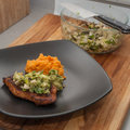 Spiced pork chop chops with charred poblano salsa and sweet potato mash Stock Image