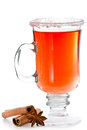 Spiced ted red tea served in a tall glass isolate don a white background with cinnamon sticks and a anise star Stock Images