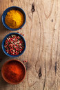 Spices background: pink and black pepper, paprika powder, curry Royalty Free Stock Photo
