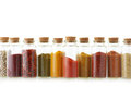 Spices in bottles assorted ground on white background Royalty Free Stock Images