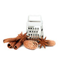 Spices cinnamon nutmeg and anise with grater isolated on white Stock Image