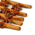 Spices closeups image of star anise and cinnamon sticks on white background Stock Image