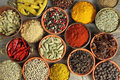Spices colorful in ceramic and metal containers beautiful kitchen image Stock Photos