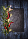 Spices food background with slate on blue wooden table top view place for text Royalty Free Stock Photo