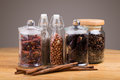 spices in glass bottles on wooden background. Royalty Free Stock Photo