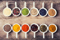 Spices and herbs in ceramic bowls on wooden background traditional indian food Stock Image