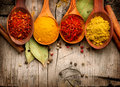 Spices and herbs over wood Royalty Free Stock Photo