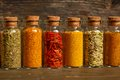 Spices herbs and seeds for cooking in little jar in a row Royalty Free Stock Photography