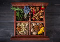 Spices and herbs in a wooden box Stock Photo