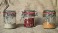 Spices in jars three glass with for cooking Royalty Free Stock Photography