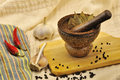 Spices and a mortar on kitchen Royalty Free Stock Images