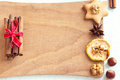Spices, nuts and cookies on cutting board Royalty Free Stock Photo