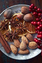 Spices nuts and dried oranges for christmas on a plate top view Royalty Free Stock Photo