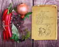 Spices and old recipe book on wooden background Royalty Free Stock Photos