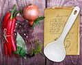 Spices and old recipe book on wooden background Stock Photo