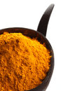 Spices - pile of bright yellow ground turmeric Royalty Free Stock Photo