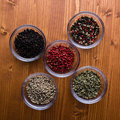 Spices in small glass bowls different colorful gourmet Royalty Free Stock Photo