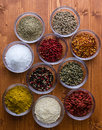 Spices in small glass bowls different colorful gourmet Royalty Free Stock Photography