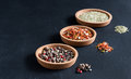 Spices in a small plates on black background Variety of spices Copy space Spice and herbs Royalty Free Stock Photo